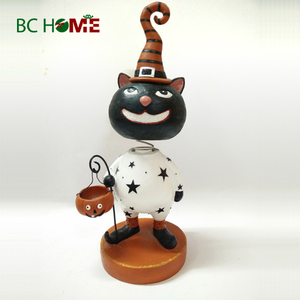 Halloween decorations cat with pumpkin hand lantern